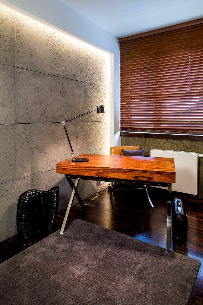 Luksusowy gabinet z betonem, masywnym biurkiem drewnianym