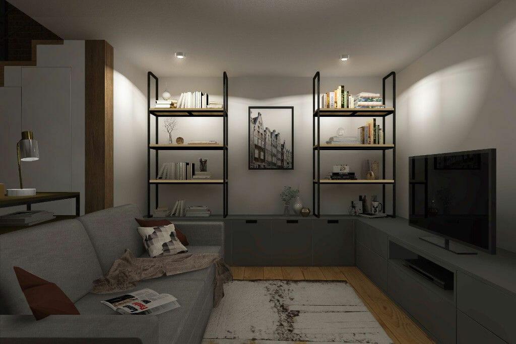 Wizualizacje apartamentu na wynajem - Warszawa, ul. Brzeska, widok na salon, strefa wypoczynkowa pod antresolą, dwuosobowa sofa z obiciem z tkaniny w kolorze szarym, szafka RTV z frontami w kolorze szarym, półki na książki wykonane z lakierowane na czarno stali i półkami z jasnego drewna, na suficie oświetlenie punktowe, Rzeszow, projektant wnętrz, Kraków, interior design, projektowanie wnętrz, projekty wnętrz