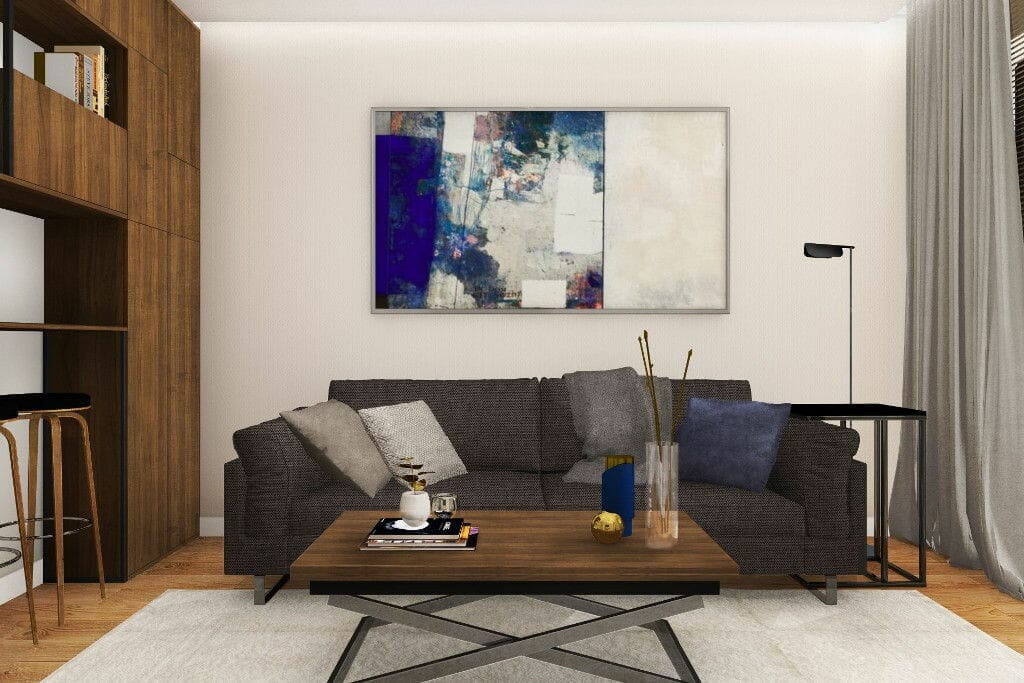 Wizualizacja salonu, widok na sofę ze stolikiem kawowym, sofa z tkaniną ciemno szarą, stolik z blatem drewnianym i nogami chromowanymi w kształcie litery X, duży obraz na ścianie, Kraków, Warszawa, Rzeszow, projekty wnętrz, pod klucz, projektant wnętrz