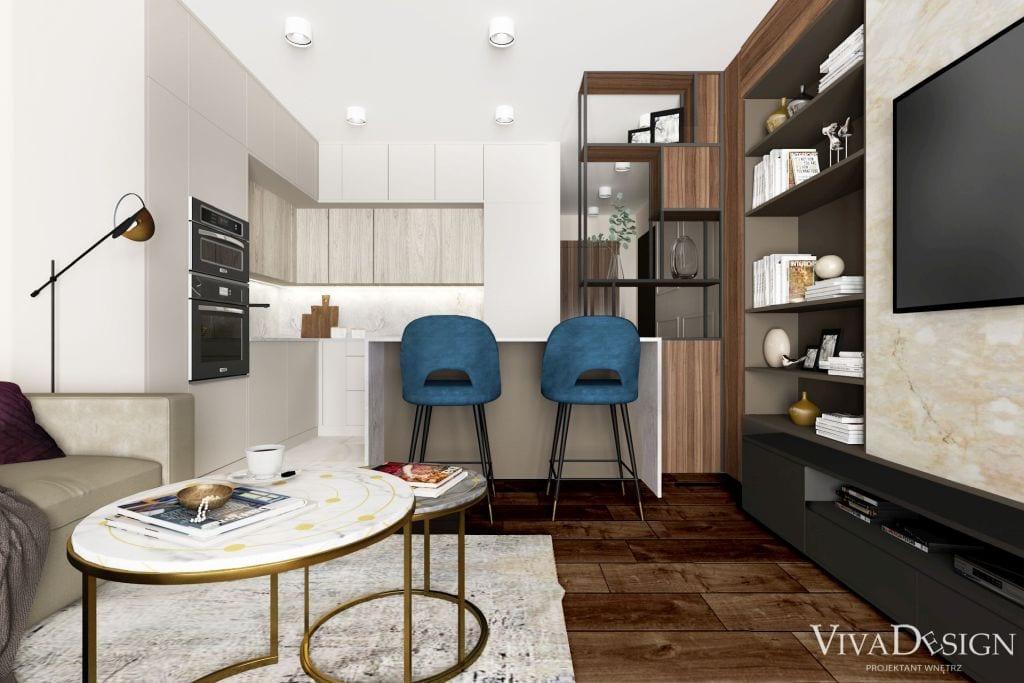 salon z aneksem małe mieszkanie ciemna podłoga drewno niebieskie hokery wyspa kuchenna